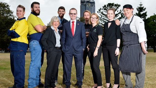 Westpac Regional State Manager for Queensland Brett English with WPC QLD State Manager Janine McPhee and apprentices.Photo: Bradley Kanaris